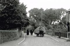 A horse and cart ambles down a road